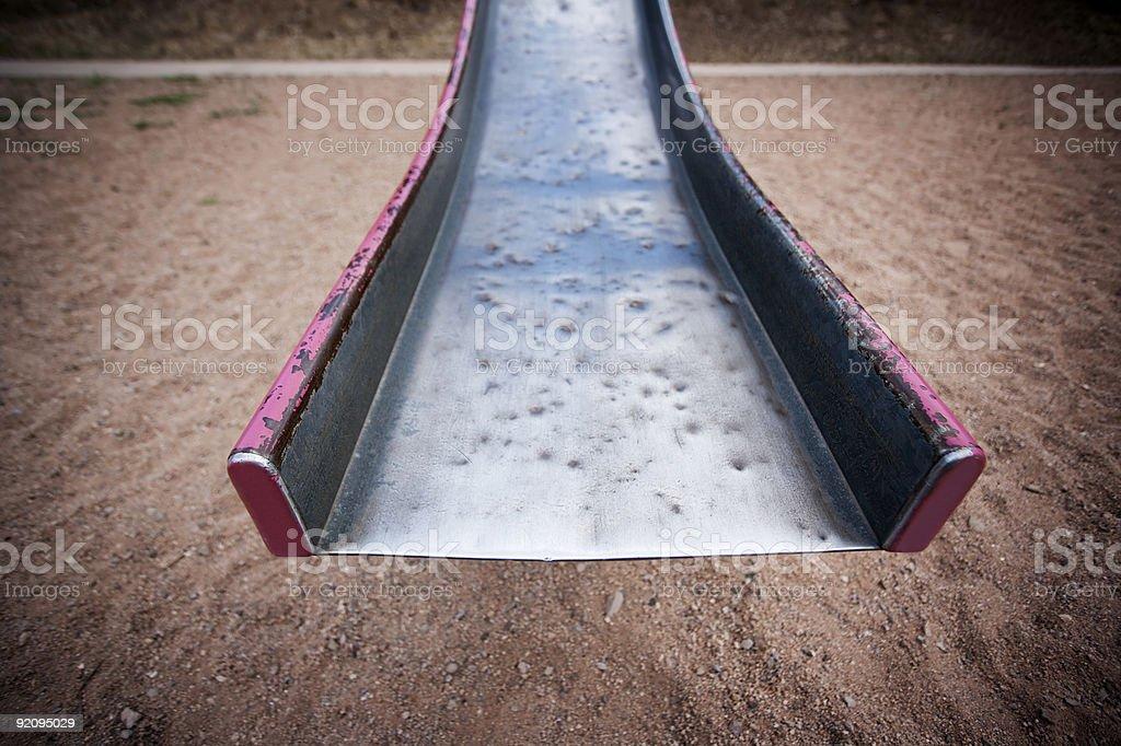 End of a battered old slide stock photo