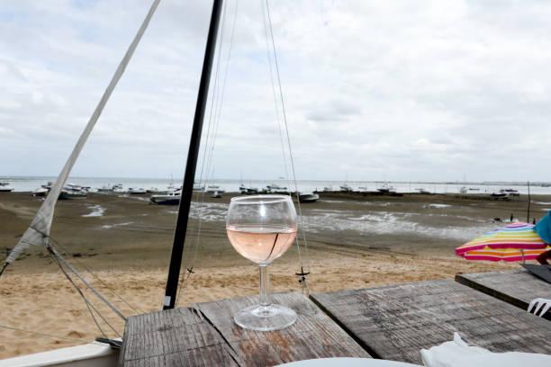 end of dinner on terrace in cafe on seaside beach - foto stock
