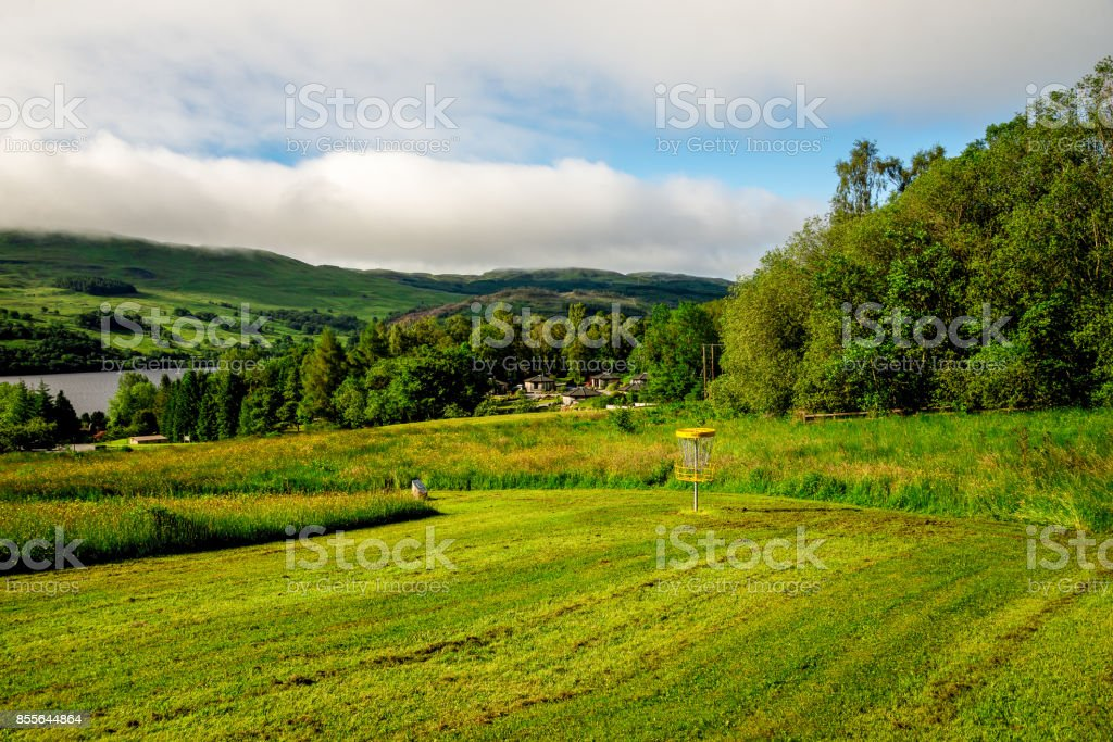 End of one of the holes at flying disc golf course near Loch Tay lake, central Scotland stock photo
