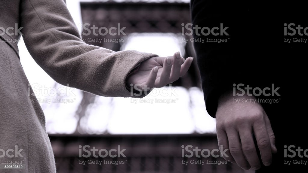 End of relationship between man and woman, hands of breakup couple, divorce stock photo