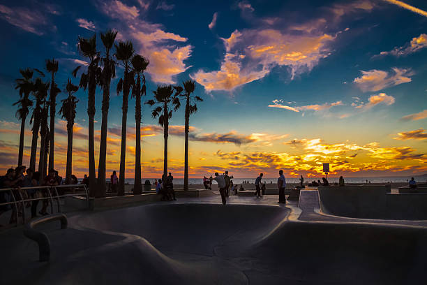 End of the hottest day Sunset makes skateboarders and audience hot at Venice beach, CA.  venice beach stock pictures, royalty-free photos & images
