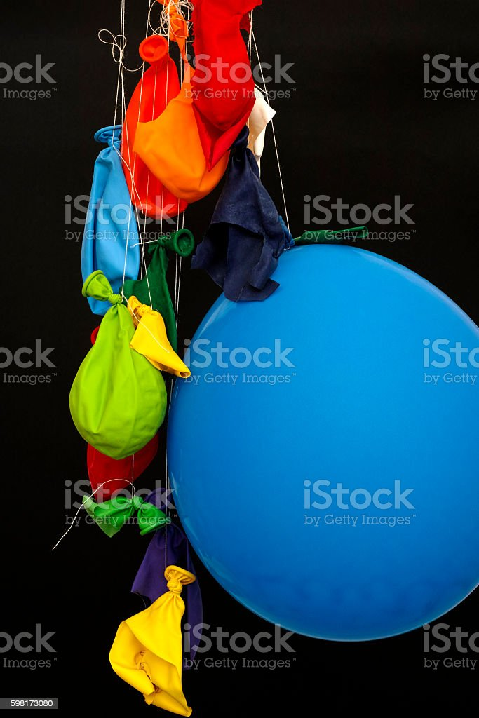 End of the party. Burst, deflated balloons stock photo