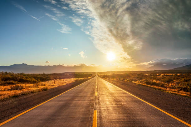 Fin Del Mundo Street in Chile - Patagonia Road, Highway, Street, Summer, Sunrise - Dawn straight stock pictures, royalty-free photos & images