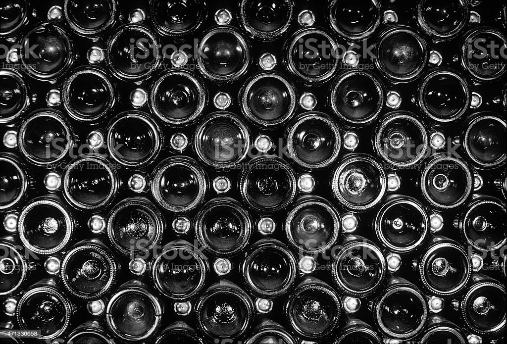 End view of vintage sparkling wine bottle stack stock photo