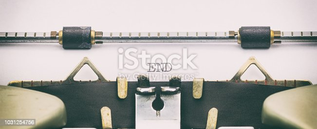 istock End word in capital letters on white sheet 1031254756