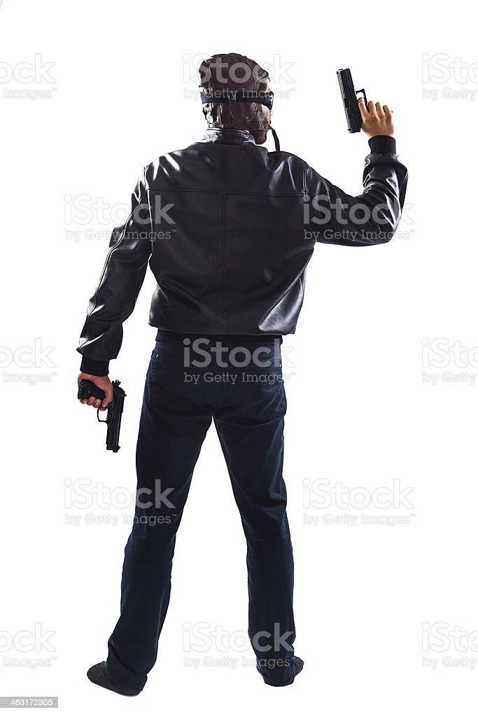 Endangering man holding guns in his hands stock photo