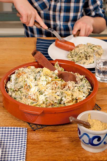 endive stew with sausage - stamppot stockfoto's en -beelden