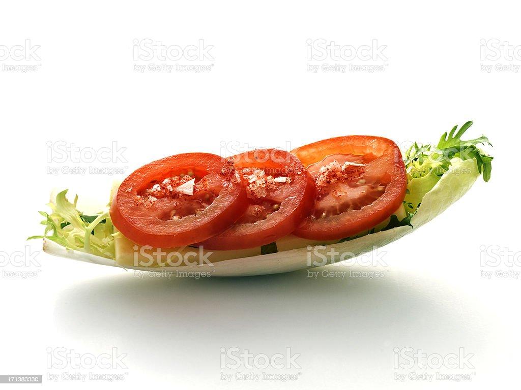 endive with tomato slices stock photo