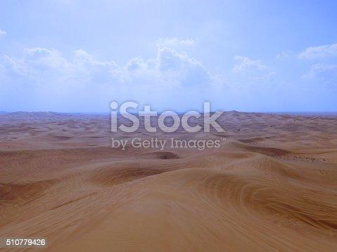Endless Desert Sand Dunes Outside Dubai With Tire Tracks