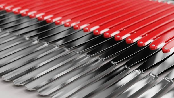 Endless line of Red Straight Razors on a modern surface Close up on a tightly packed, perfectly aligned linear array of variously colored Straight Razors on a simple modernist neutral surface. This image is a 3d render. cutthroat stock pictures, royalty-free photos & images