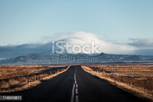 long road in one straight direction in iceland.
