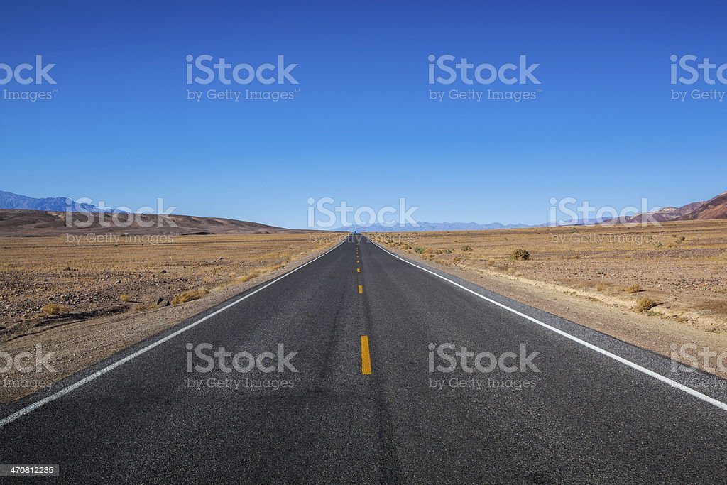 Endless road in Death Valley stock photo