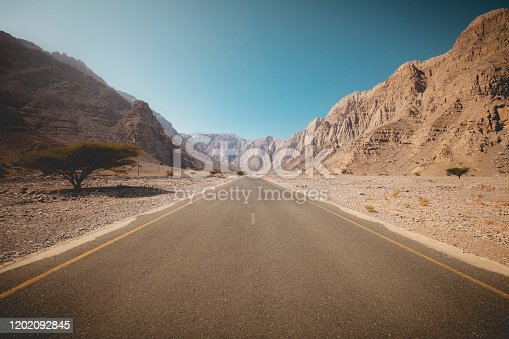 endless road through al hajar mountains in the sultanate of oman.
