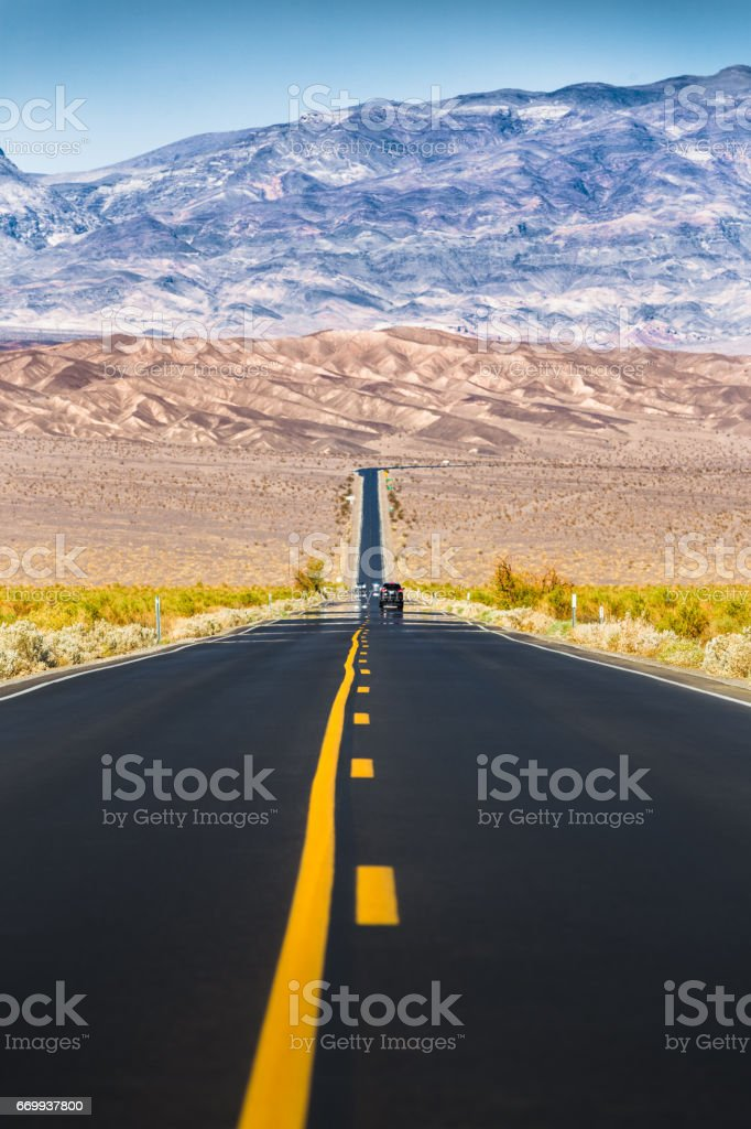 endless straight road in death valley national park california usa
