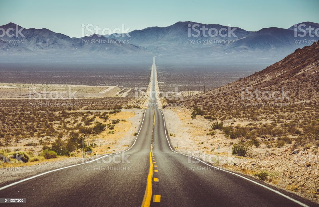 Endless straight road in the American Southwest, USA stock photo