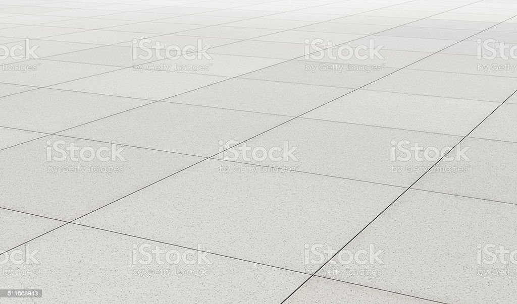 Endless surface covered with gray concrete tiles stock photo