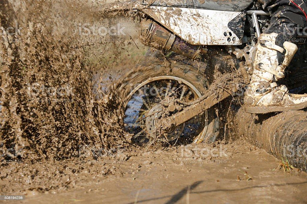 Enduro wheel in muddy track stock photo