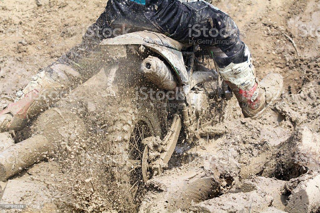 Enduro-cross in muddy stump track stock photo