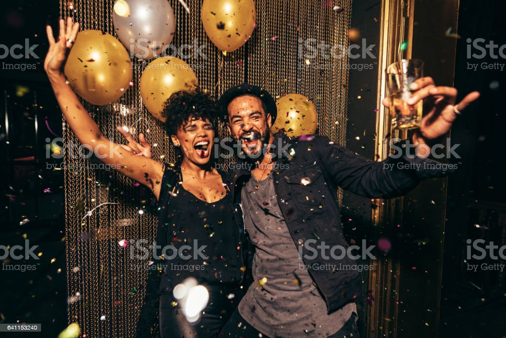 Energetic couple dancing in the night club stock photo