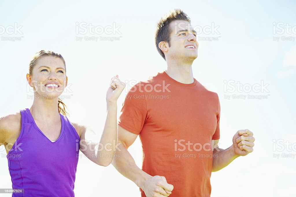 Energetic couple running together royalty-free stock photo