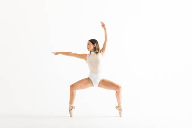 energetic female dancer performing ballet squat - leotard stock pictures, royalty-free photos & images