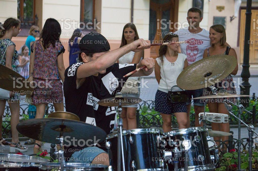 Energetic street drummer. Charity concert stock photo