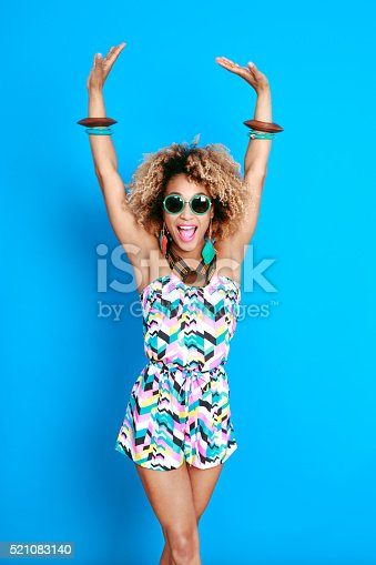 521083232istockphoto Energetic summer afro young woman 521083140