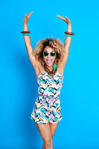 1062933270 istock photo Energetic summer afro young woman 521083140
