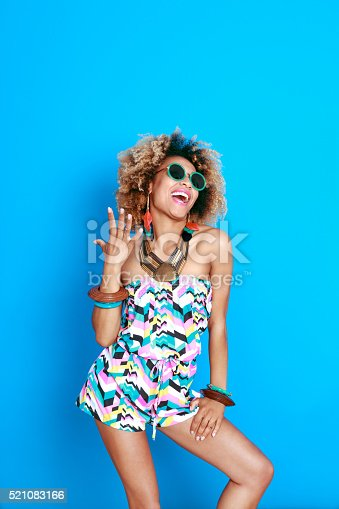 521083232istockphoto Energetic summer afro young woman 521083166