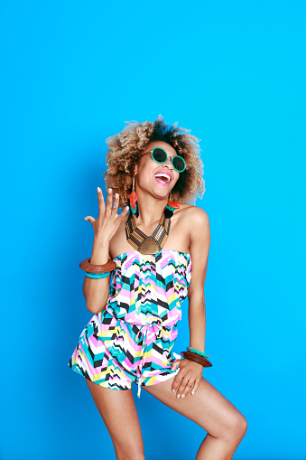 1062933270 istock photo Energetic summer afro young woman 521083166