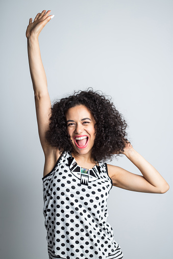 Energetic Woman Celebrating Success Stock Photo - Download Image Now