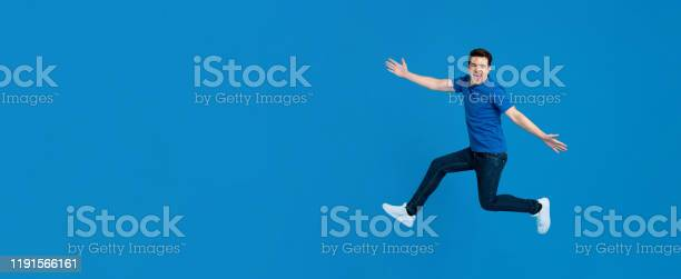 Energetic young man jumping and smiling with outstretched hands picture id1191566161?b=1&k=6&m=1191566161&s=612x612&h=m2cqodthqq3o4qazyhy172ki8jkftlyky4wg 3oi4we=