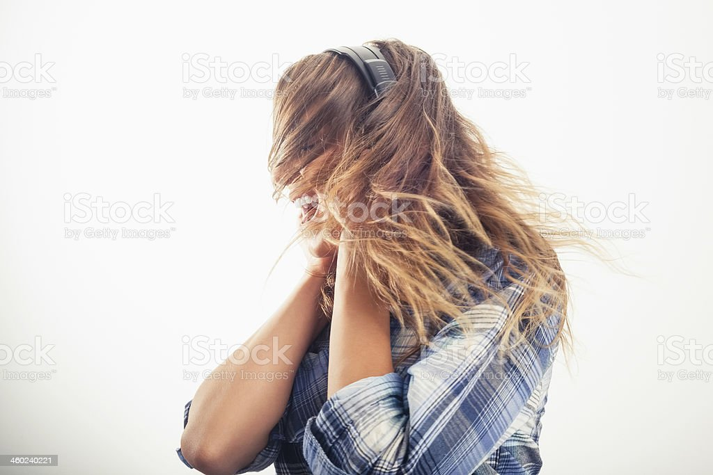 Energetic Young Model Listening To Music Stock Photo
