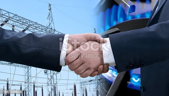 Businessmen handshaking in front if a power station and close up stove detail with burning flame