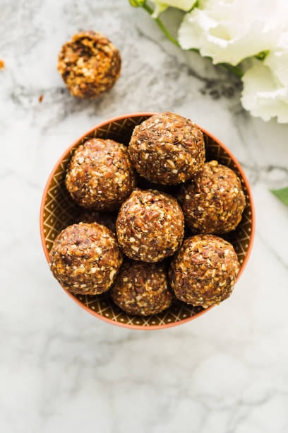 Energy balls with healthy ingredients on marble stock photo