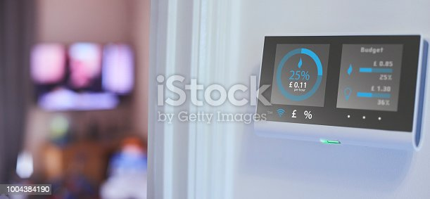 Smart meter on the wall of home interior showing current energy costs  Design on screen my own. Please see property release.