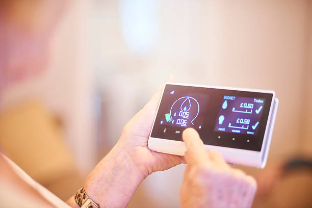 energieverbrauch - messgerät stock-fotos und bilder