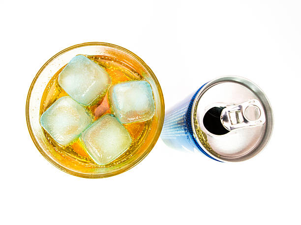 Energy drink can with full glass stock photo