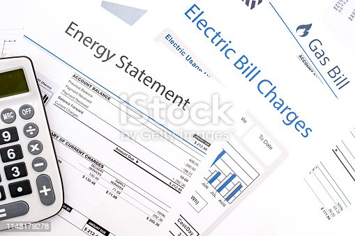 istock Energy efficiency concept and energy bill papers 1148179278