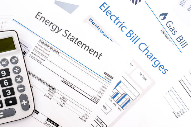 Energy efficiency concept and energy bill papers Energy bill paper forms on the table closeup expense stock pictures, royalty-free photos & images