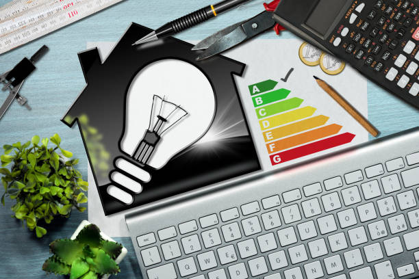 energy efficiency rating - house with light bulb - energy performance certificate stock photos and pictures