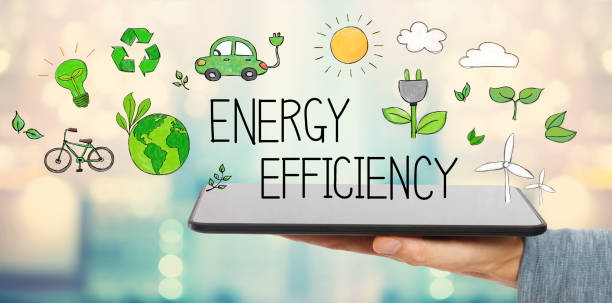 energy efficiency with man holding a tablet - risparmio energetico foto e immagini stock