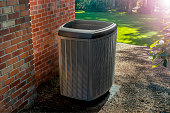 istock Energy efficient heat pump with a sun flare 1315698141