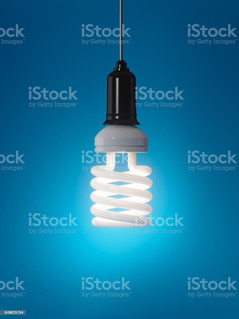 Energy Efficient Light Bulb Over Blue Background: Energy Saving Concept stock photo