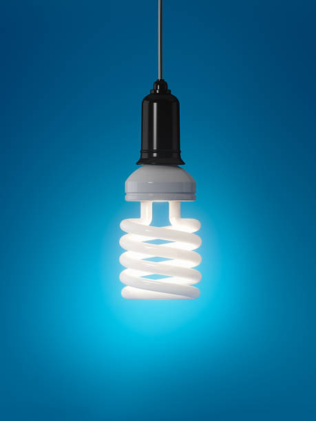Energy Efficient Light Bulb sur fond bleu : Energie Concept - Photo