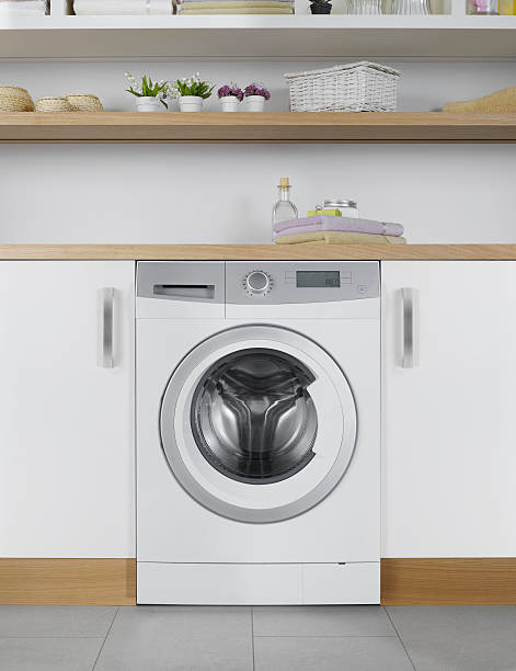 energy efficient washing machine - laundry laundry room stock pictures, royalty-free photos & images
