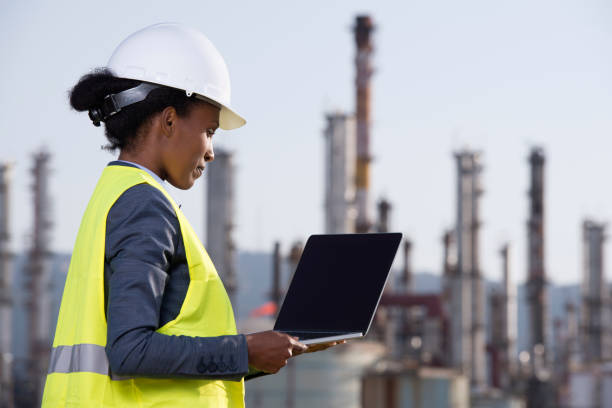 Energy engineer working at refineries checking data. stock photo
