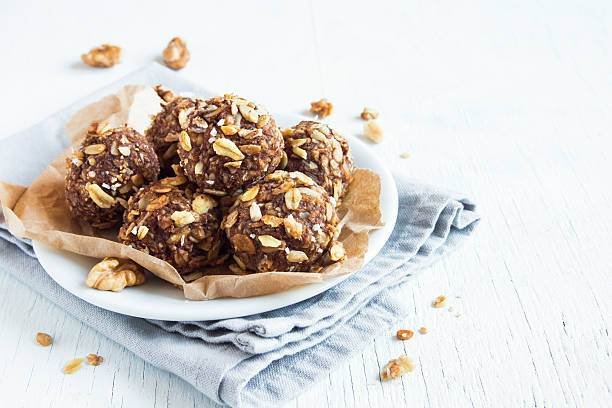 energy granola bites - oats food stock photos and pictures