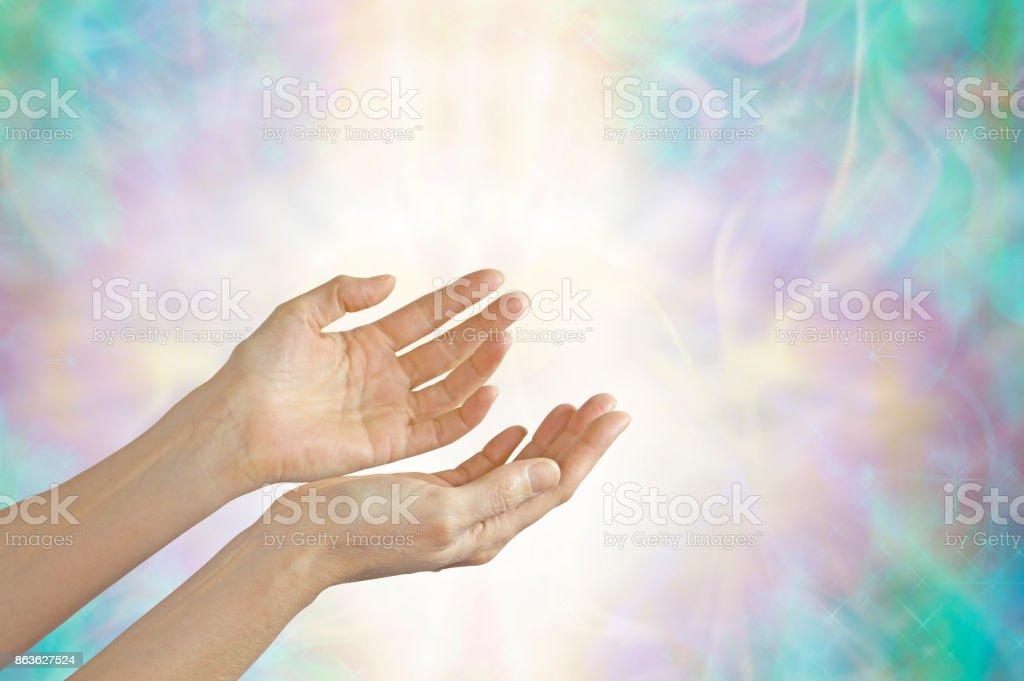 Energy healer with open hands stock photo