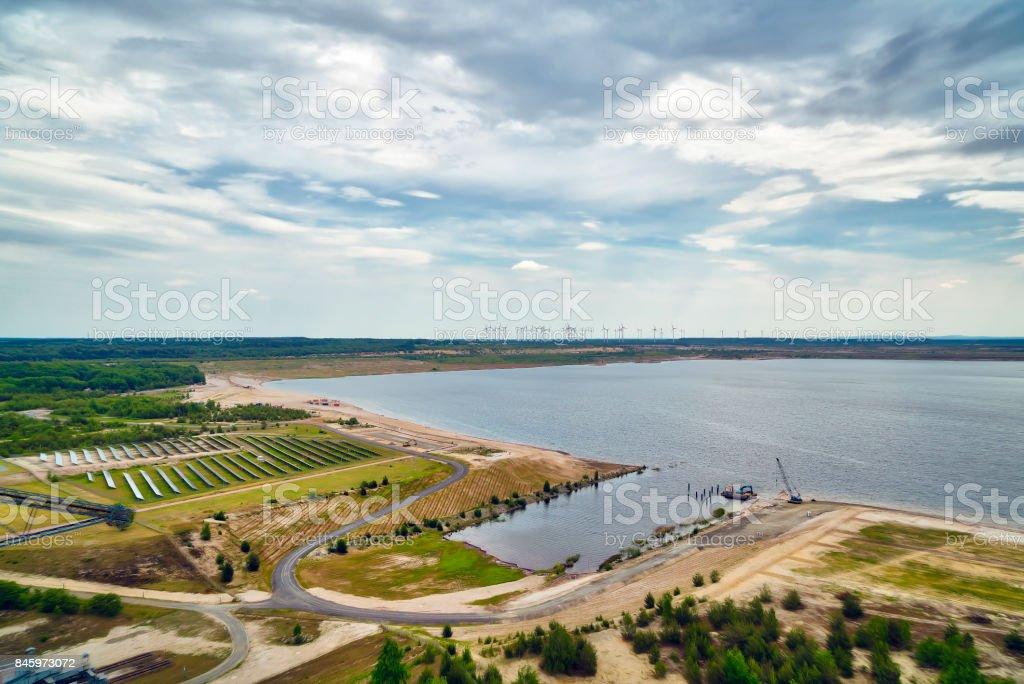 energy park: lignite, solar power plant and wind turbines stock photo